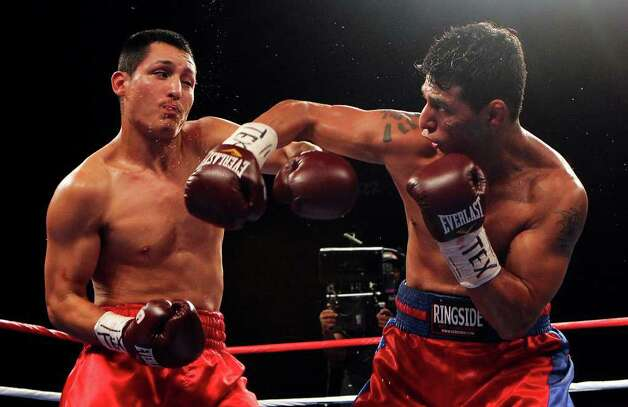 Mark Trujillo (left) of San Antonio takes on Randy Fuentes in a welterweight bout for ESPN Fight Night at the Freeman Coliseum on Friday, July 1, 2011. Trujillo lost the bout. Photo: Kin Man Hui/kmhui@express-news.net / San Antonio Express-News