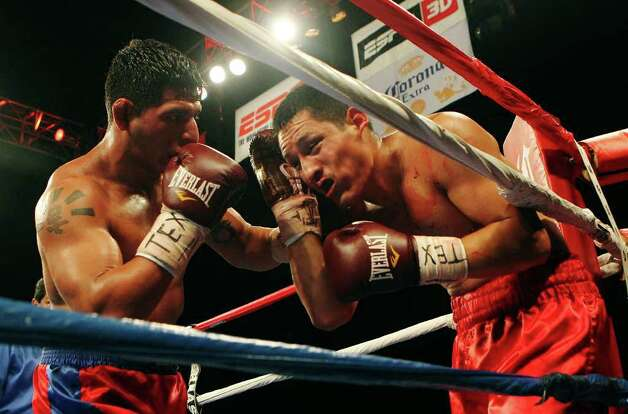 Mark Trujillo (right) of San Antonio gets backed into his corner by opponent Randy Fuentes in a welterweight bout for ESPN Fight Night at the Freeman Coliseum on Friday, July 1, 2011. Trujillo lost the bout. Photo: Kin Man Hui/kmhui@express-news.net / San Antonio Express-News