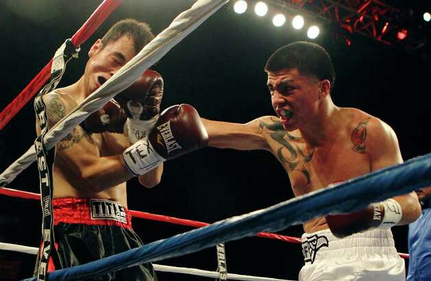 Ivan Najera (right) of San Antonio takes on Pedro Martinez in a lightweight bout for ESPN Fight Night at the Freeman Coliseum on Friday, July 1, 2011. Najera won on a TKO after the first round. Photo: Kin Man Hui/kmhui@express-news.net / San Antonio Express-News