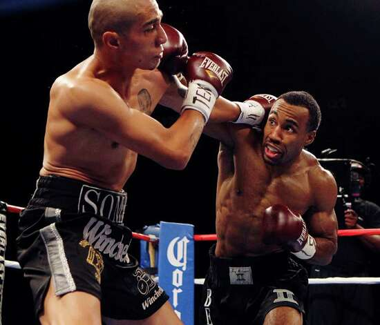 Mickey Bey (right) lands a punch against Alejandro Rodriguez in a lightweight bout for ESPN Fight Night at the Freeman Coliseum on Friday, July 1, 2011. Bey won by knockout in the fourth round. Photo: Kin Man Hui/kmhui@express-news.net / San Antonio Express-News