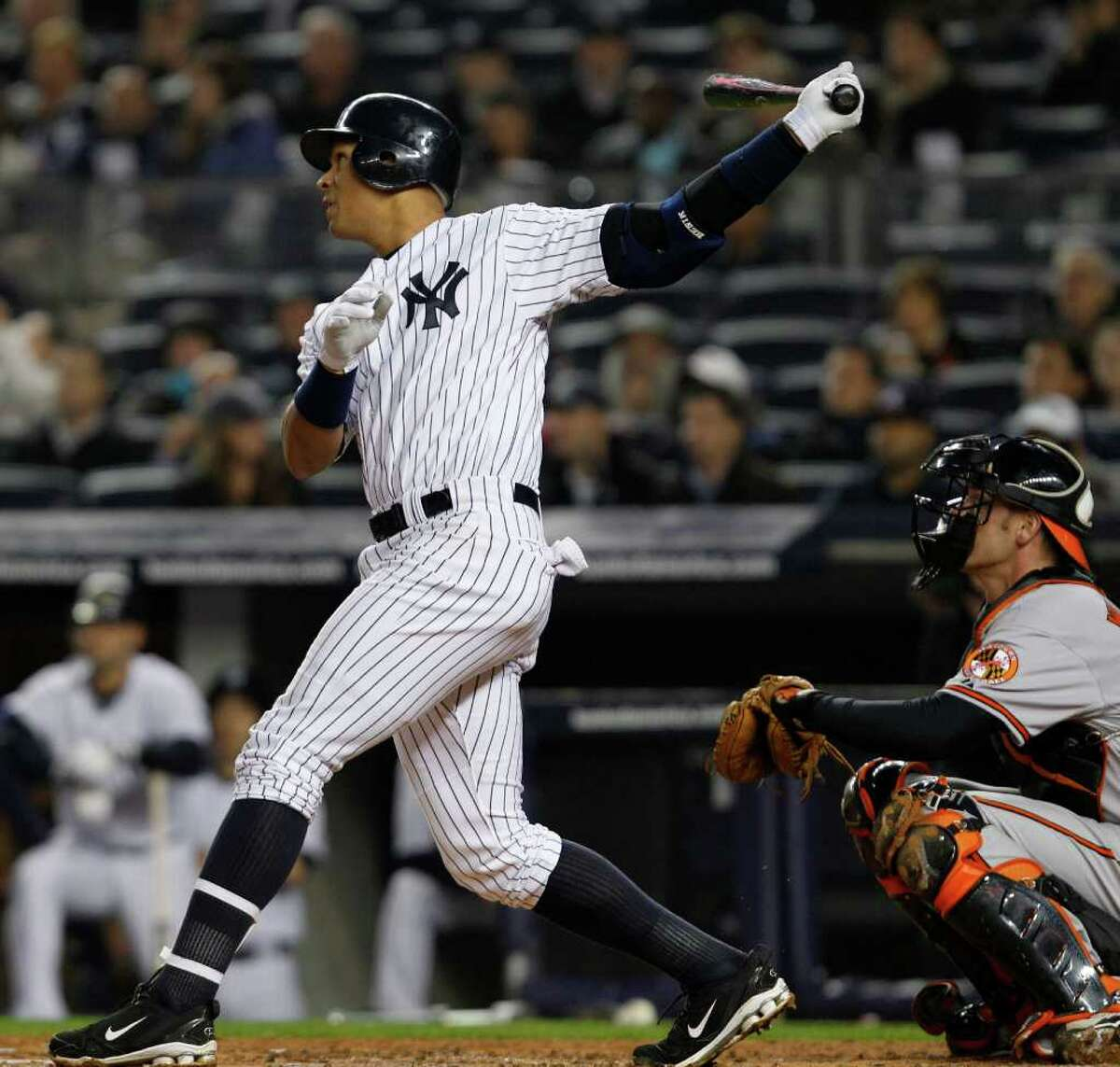 Alex Rodriguez watches a home run off Baltimore Orioles starting pitcher Chris Tillman in a game at Yankee Stadium April 13. (AP Photo/Kathy Willens)