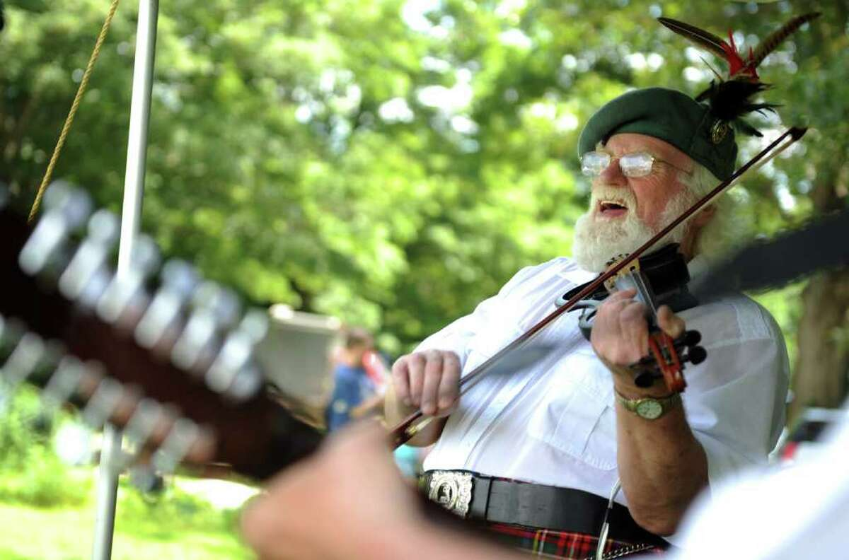 Ron Stewart performs with Tamo Shanter during the 88th Annual Round Hill Highland Games at Cranbury Park in Norwalk, Conn. Saturday, July 2, 2011.
