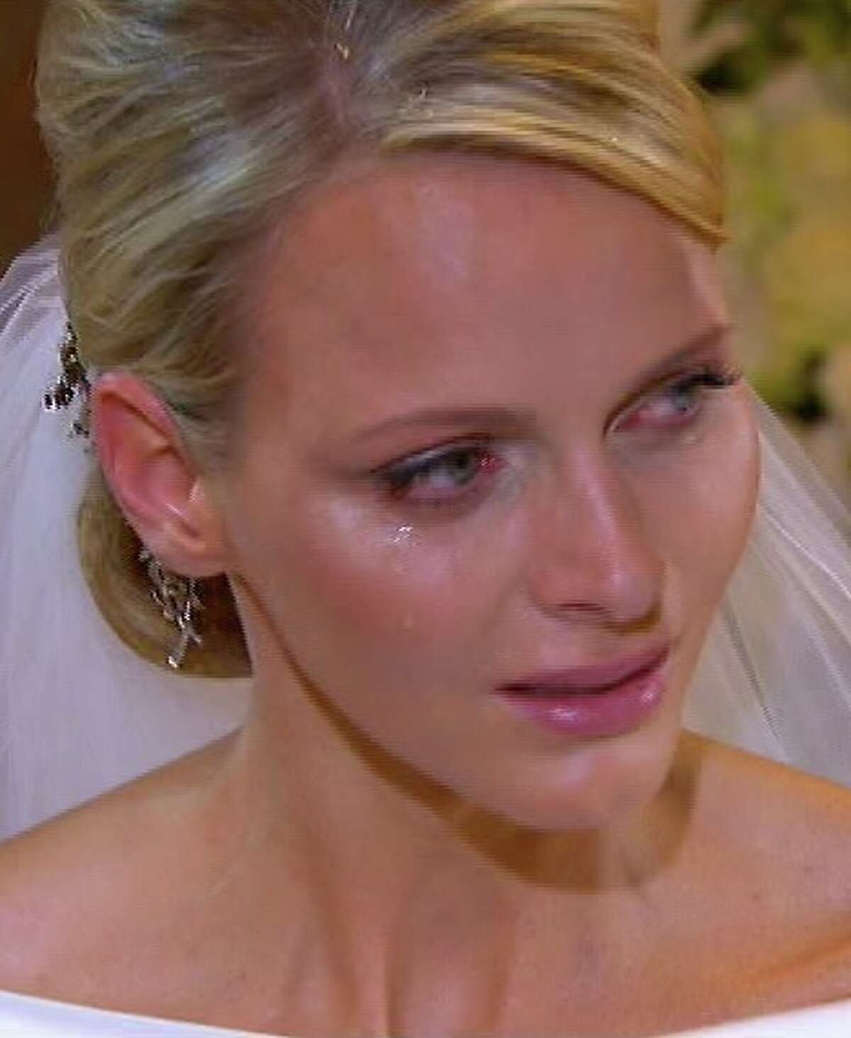 This image taken from the pool television service via Associated Press Television News shows Charlene Princess of Monaco with a tear on her cheek during the wedding service in the chapel of the Sainte Devote Church to Prince Albert II of Monaco, unseen, Saturday, July 2, 2011. (AP Photo/Television Pool via APTN) NO ARCHIVE PHOTO MAY NOT BE USED FOR MORE THAN 14 DAYS FROM SATURDAY