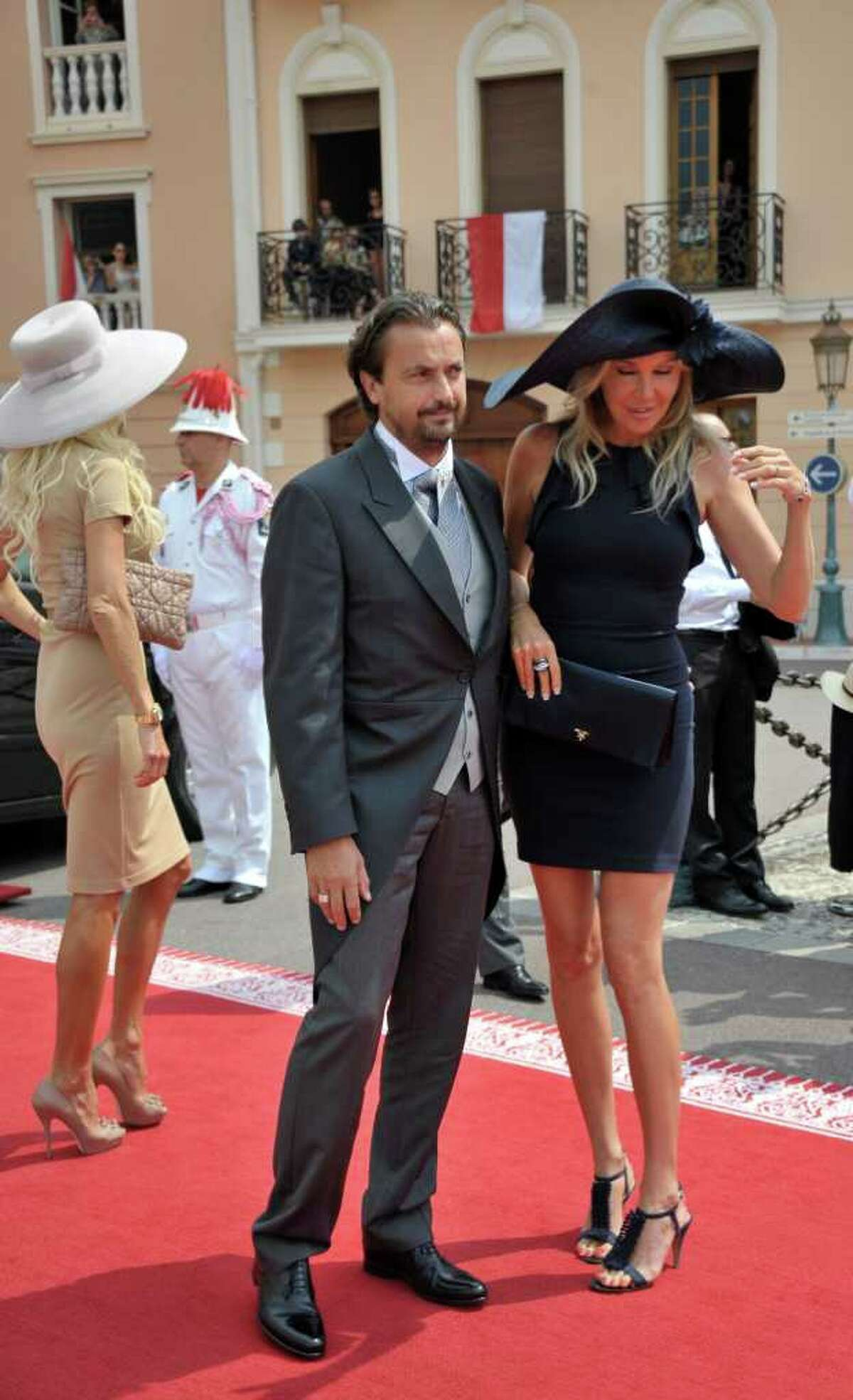 Former French tennis player Henri Leconte and his wife Florentine arrive at the Monaco palace for the religious wedding ceremony of Prince Albert II of Monaco and Charlene Princess of Monaco, Saturday, July 2, 2011.