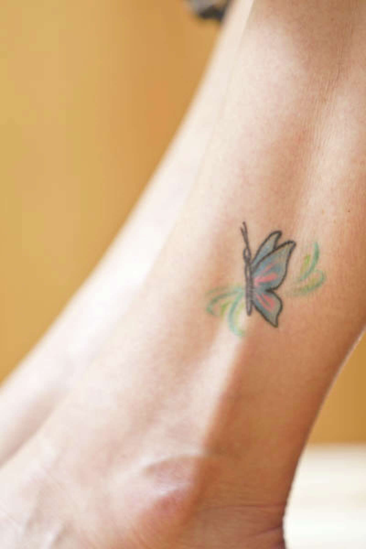 """HealthyLife cover model Pam Lejeunesse, 53, of Clifton Park, got a butterfly tattoo on her ankle as a way to bond with her daughters, Heather and Ashley, during a vacation in Virginia a few years ago. """"It was spur-of-the-moment to an extent, although we planned it once we were down there, choosing the place to go and the designs we wanted,"""" she says. """"We had been talking about getting tattoos for a long time."""" (Photo by Suzanne Kawola/HealthyLife)"""