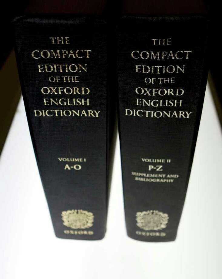 """FILE - In this Aug. 29, 2010 file photo, an Oxford English Dictionary is shown at the headquarters of The Associated Press in New York. A report that Oxford University had changed its comma rule left some punctuation obsessives alarmed, annoyed, and distraught. Passions subsided as the university said the news was imprecise, incomplete and misleading. Oxford University Press, birthplace of the Oxford comma, said Thursday, June 30, 2011, that there has been no change in its century-old style, and jumped into the Twittersphere to confirm that it still follows the standard set out in """"New Hart's Rules.""""  (AP Photo/Caleb Jones) Photo: Caleb Jones / AP"""