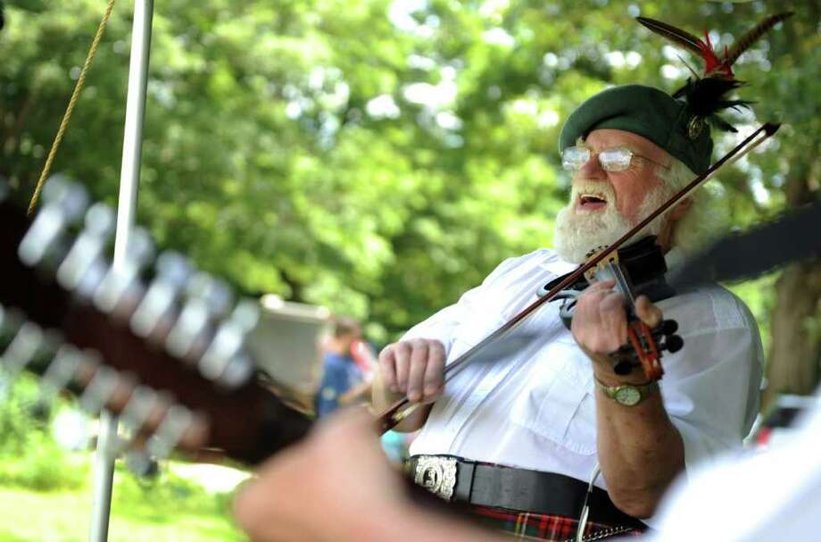 Ron Stewart performs with Tamo Shanter during the 88th Annual Round Hill Highland Games at Cranbury Park in Norwalk, Conn. Saturday, July 2, 2011. Photo: Autumn Driscoll / Connecticut Post