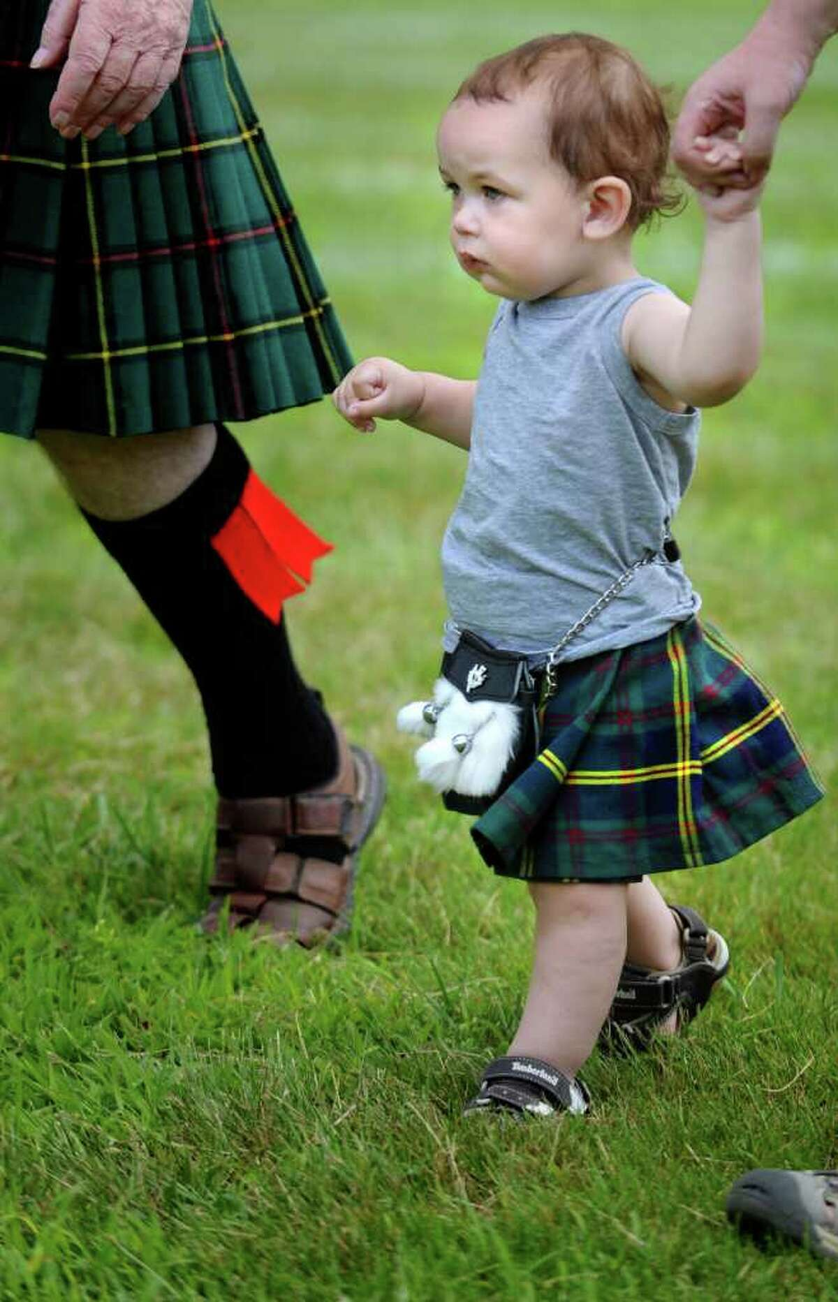 One-year-old Liam Mattice, of Trumbull, marches onto center field with clan Malcolm during opening ceremonies of the 88th Annual Round Hill Highland Games at Cranbury Park in Norwalk, Conn. Saturday, July 2, 2011.