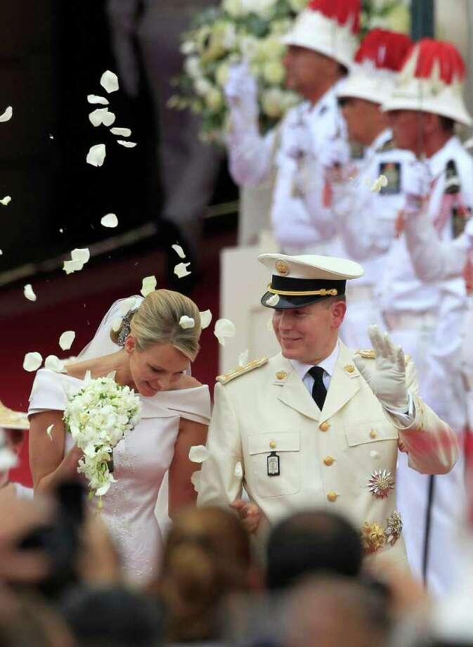 Prince Albert II of Monaco and Princess Charlene of Monaco depart from the Monaco palace after their religious wedding ceremony , Saturday, July 2, 2011.  (AP Photo/Jean Paul Pelissier, Pool) Photo: Jean Paul Pelissier