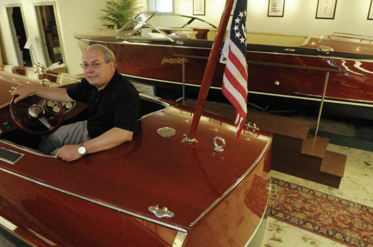 George Badcock, president and CEO of the Hacker Boat Company, sits in one of the company's racers in the showroom on Monday, June 27, 2011 in Silver Bay. Hacker Boat Company is relocating its production facilities to Queensbury from Ticonderoga this spring, with a new showroom to follow.(Paul Buckowski / Times Union)