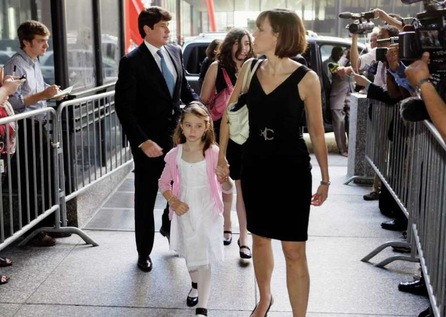 FILE   In this July 26, 2010 file photo, former Illinois Gov. Rod Blagojevich, left, and his wife Patti, right, arrive at the federal courthouse with their daughters Annie, front holding Patti's hand, and Amy, in Chicago during his first trial on corruption charges. The fallout from Blagojevich's slam-dunk conviction on corruption charges in his retrial June 27, 2011, poses no end of difficulties for him and his family. While he and his wife, the daughter of an influential Chicago alderman, have connections, she and their two school-age daughters could face some financial jeopardy, with Blagojevich's sentence possibly lasting through the two girls' high school and college years.  (AP Photo/M. Spencer Green, File) Photo: M. Spencer Green