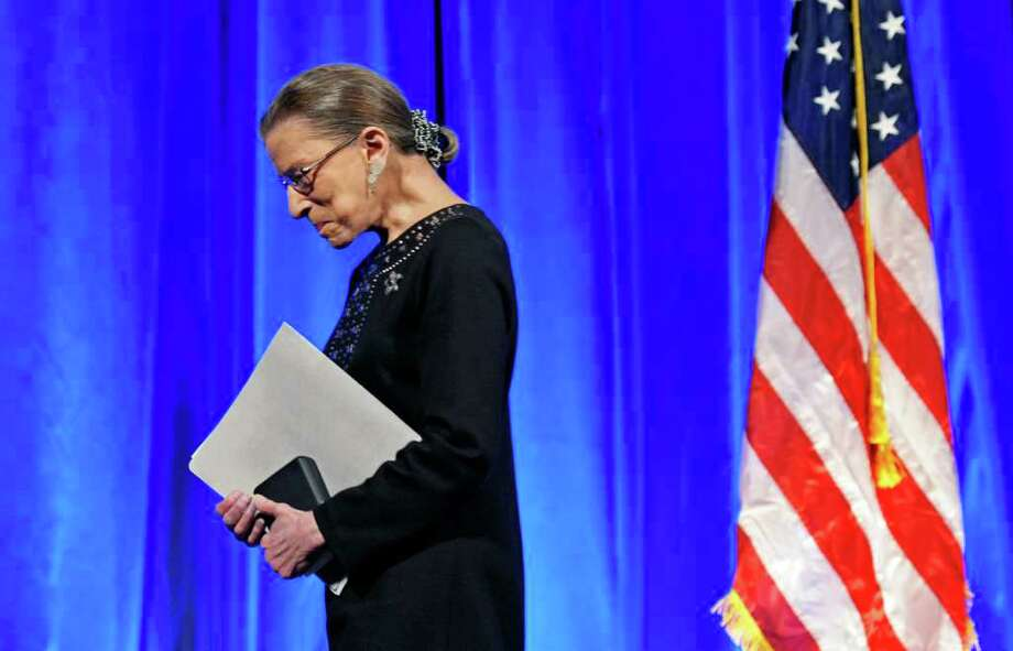 FILE - In this June 21, 2011, file photo Supreme Court Associate Justice Ruth Bader Ginsburg walks off stage after receiving a Jefferson Award for Public Service in Washington. Before becoming the second female justice on the nation's high court in 1993, Ginsburg had been a judge, a professor and a lawyer for the American Civil Liberties Union, who focused on gender equality. She has said gracefully, and with apparent good humor, that the president should not expect a retirement letter from her before 2015. (AP Photo/Cliff Owen, File) Photo: Cliff Owen