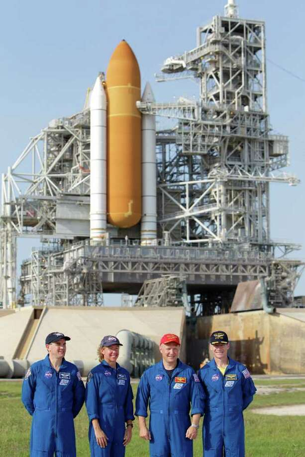 ADVANCE FOR USE SUNDAY, JULY 3, 2011 AND THEREAFTER - FILE - In this Wednesday, June 22, 2011 file picture, the crew of space shuttle Atlantis, from left, mission specialist Rex Walhiem, mission specialist Sandy Magnus, pilot Doug Hurley and commander Chris Ferguson attend a news conference at Pad 39A during the Terminal Countdown Demonstration Test at the Kennedy Space Center in Cape Canaveral, Fla. The launch of Atlantis, the final space shuttle mission, is scheduled for July 8. (AP Photo/John Raoux) Photo: John Raoux