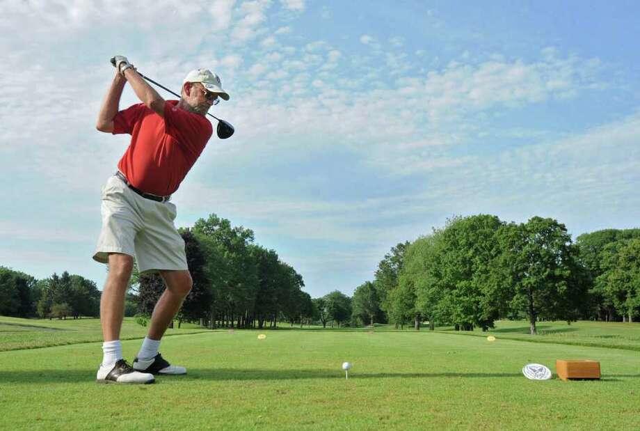 Doug Hamilton of Niskayuna tees off at the Mohawk Golf Club in Niskayuna, where dress codes have been relaxed as a way to appeal to more people. (Lori Van Buren / Times Union) Photo: Lori Van Buren