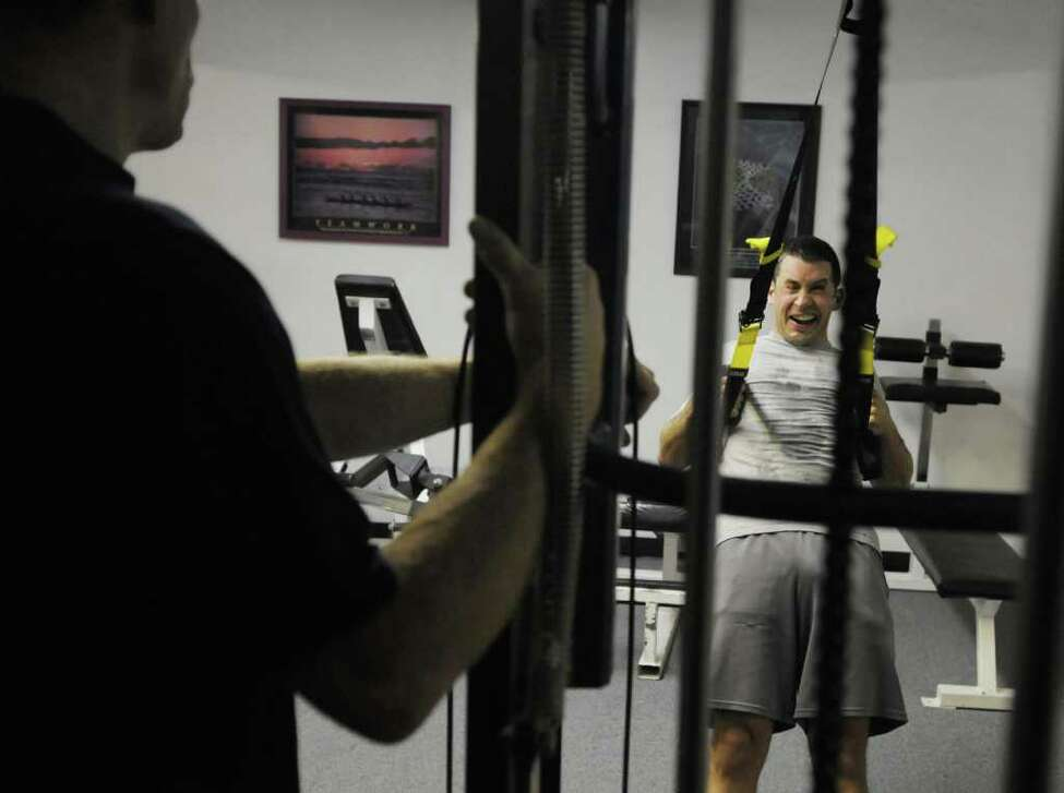 Joey Miranda works out with trainer/gym owner Mark Boudreau at My Gym in Ballston Spa. (Paul Buckowski / Times Union)