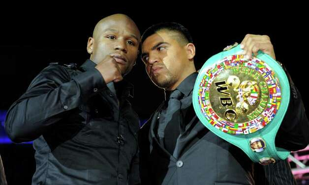 Floyd Mayweather Jr. (left) is promoting his Sept. 17 bout against WBC welterweight champion Victor Ortiz, but continues to say he wants to fight Manny Pacquiao. Photo: Mark J. Terrill/Associated Press