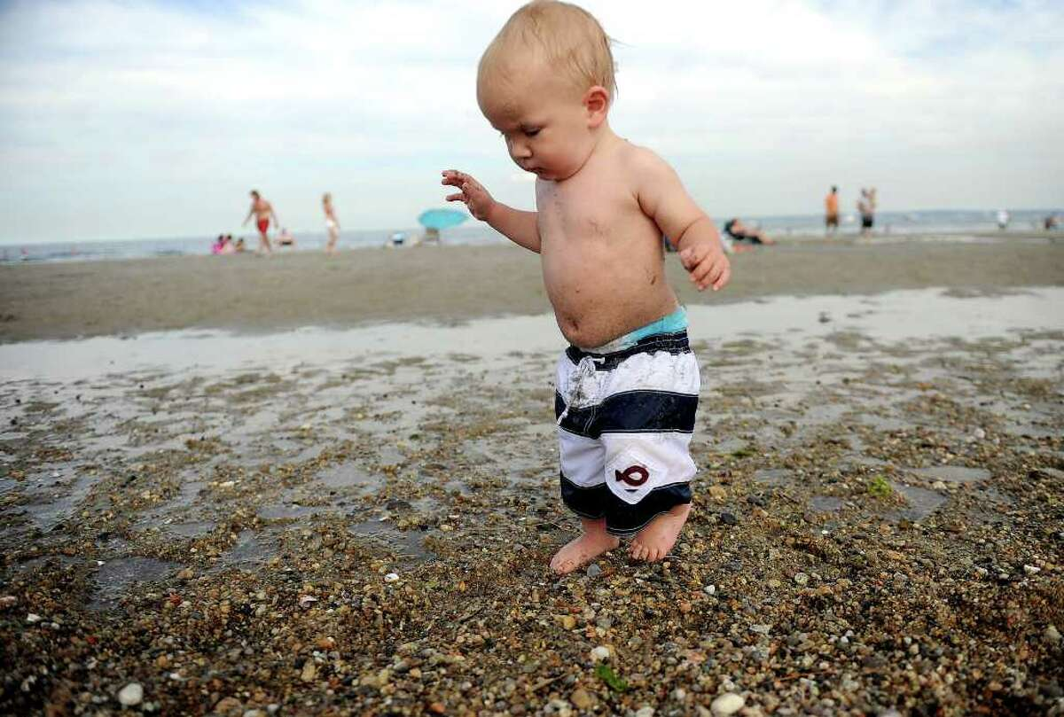 Yacha Kegeles, 1, walks on the beach at Greenwich Point on Saturday, July 2, 2011.