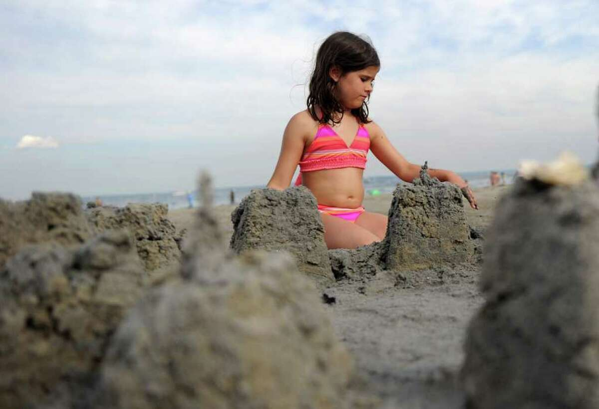 Miranda Huff, 8, builds a sand castle at Greenwich Point on Saturday, July 2, 2011.