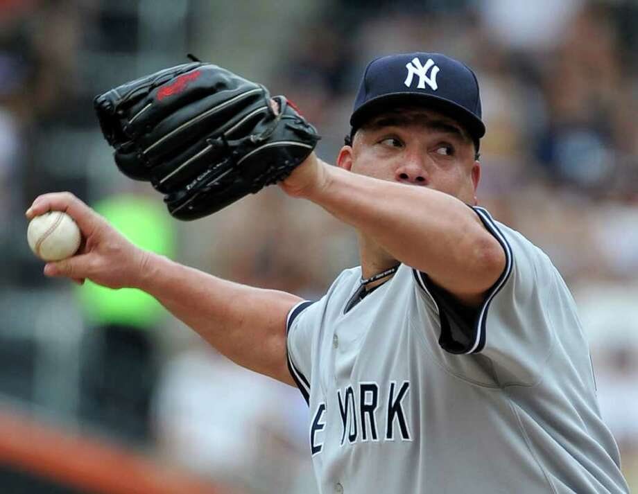 New York Yankees starting pitcher Bartolo Colon throws against the New York Mets in the first inning of a baseball game, Saturday, July 2, 2011, at Citi Field in New York. The Yankees won 5-2. (AP Photo/Kathy Kmonicek) Photo: Kathy Kmonicek