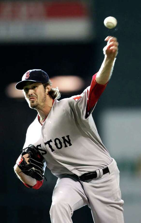 Boston Red Sox starting pitcher Andrew Miller throws during the first inning of an interleague baseball game against the Houston Astros, Saturday, July 2, 2011, in Houston. (AP Photo/David J. Phillip) Photo: David J. Phillip