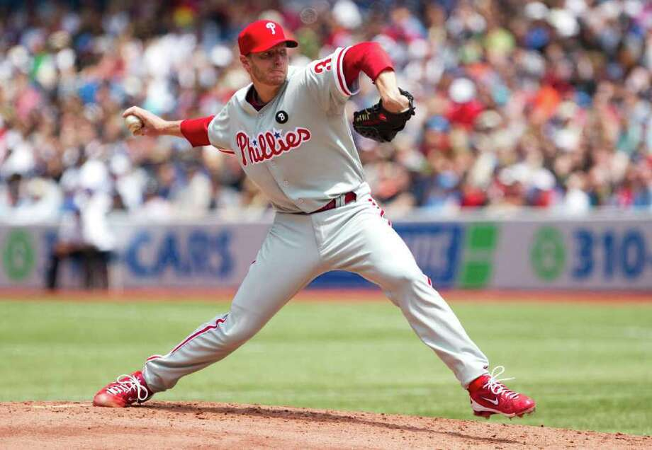 Philadelphia Phillies pitcher Roy Halladay works against the Toronto Blue Jays during the first inning of an interleague baseball game in Toronto Saturday, July 2, 2011. (AP Photo/The Canadian Press, Darren Calabrese) Photo: Darren Calabrese