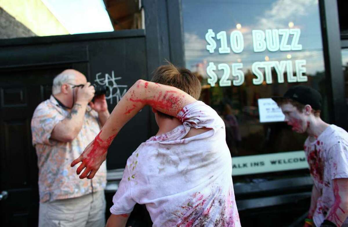 Lewis Page, 15, walks with his arm behind his head during the Red White and Dead zombie walk on Saturday.