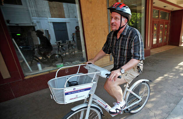 "Phillip Schrank, owner of Gallery Vetro, rides a B-cycle bike he checked out from the East Houston Street stand. He's one of the top users in the system, ""I call myself the 'spokes-person,' "" he jokes. Photo: Andrew Buckley/abuckley@express-news.net"
