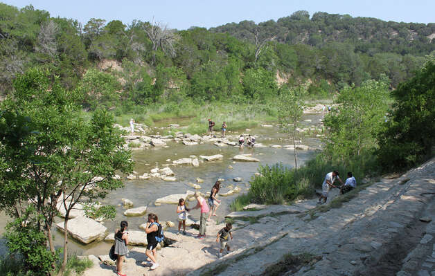 Visitors to Dinosaur Valley State Park explore along the Paluxy River, where marine fossils and dinosaur tracks can be spotted. KATHLEEN SCOTT / SPECIAL TO THE EXPRESS-NEWS
