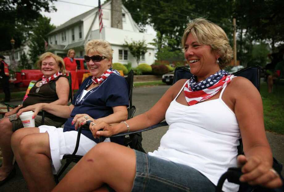 From left; Maureen Linder felt of Fairfield, Teri McMahon of Stratford, and Theresa Bardes of Fairfield, all former Bridgeporters, wear matching patriotic bandanas for the annual Barnum Festival Great Street Parade on Park Avenue in Bridgeport on Sunday, July 3, 2011. Photo: Brian A. Pounds / Connecticut Post