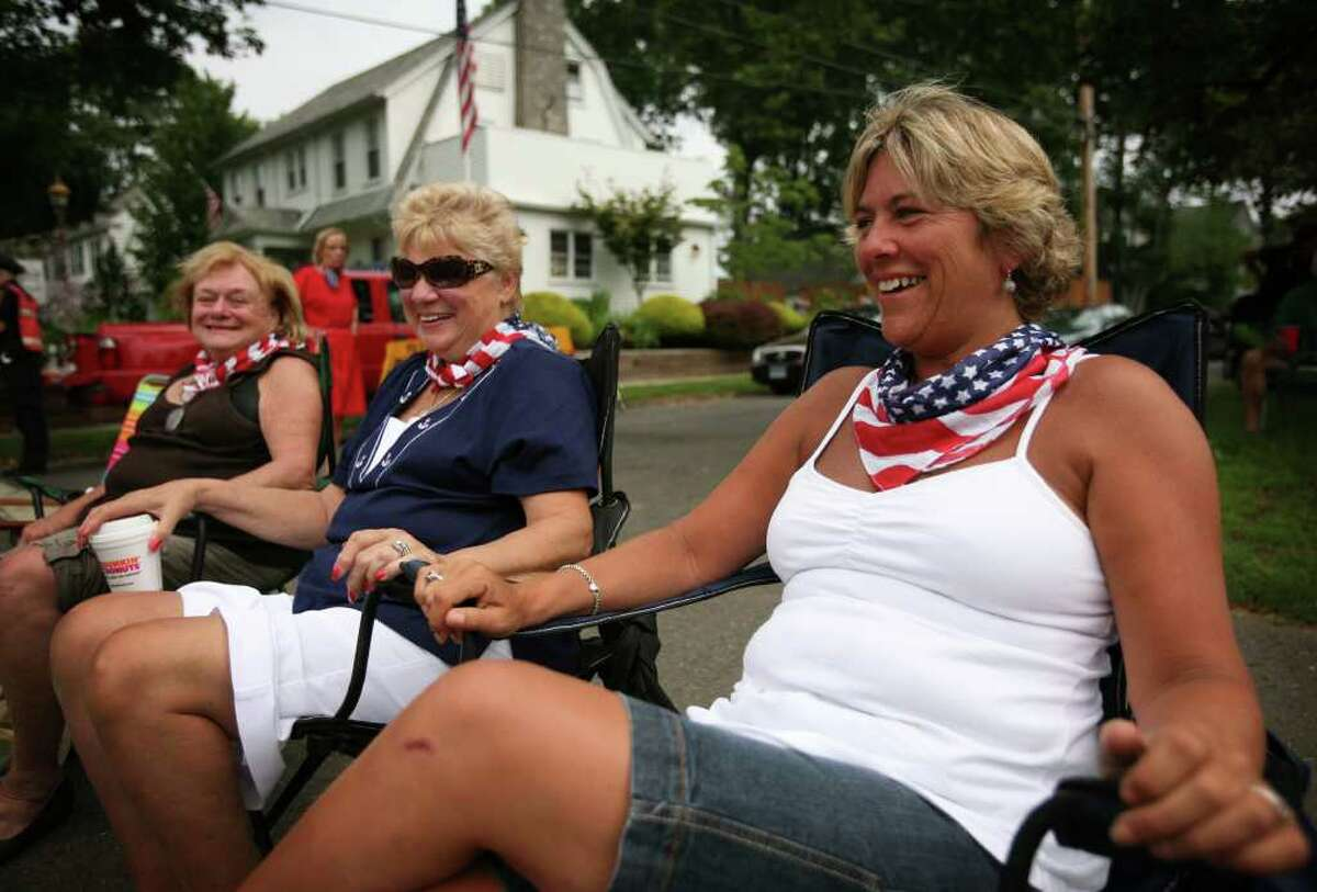 From left; Maureen Linder felt of Fairfield, Teri McMahon of Stratford, and Theresa Bardes of Fairfield, all former Bridgeporters, wear matching patriotic bandanas for the annual Barnum Festival Great Street Parade on Park Avenue in Bridgeport on Sunday, July 3, 2011.