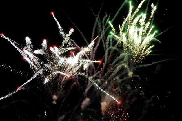 Fireworks burst over the Mohawk River on Friday, July 1, 2011, at Freedom Park in Scotia, N.Y. (Cindy Schultz / Times Union) Photo: Cindy Schultz