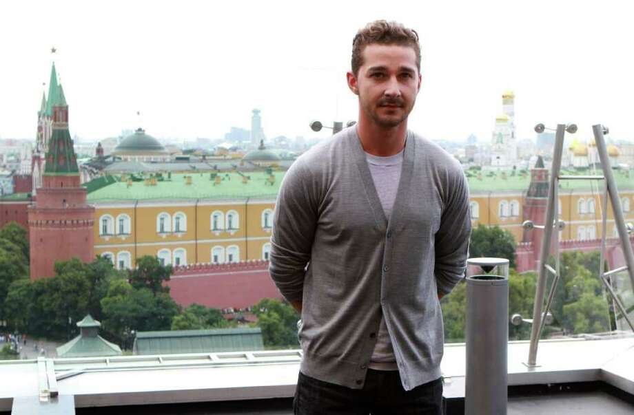 "FILE * In this Thursday, June 23, 2011 file photo actor Shia LaBeouf poses during a photo call for the world premiere of Hollywood blockbuster Transformers: Dark of the Moon, in Moscow. The 26-year-old actor told The Associated Press he was ""done"" with the action-packed franchise, adding he ""doesn't have anything new to contribute."" (AP Photo/Yury Samolygo) Photo: Yury Samolygo / AP"