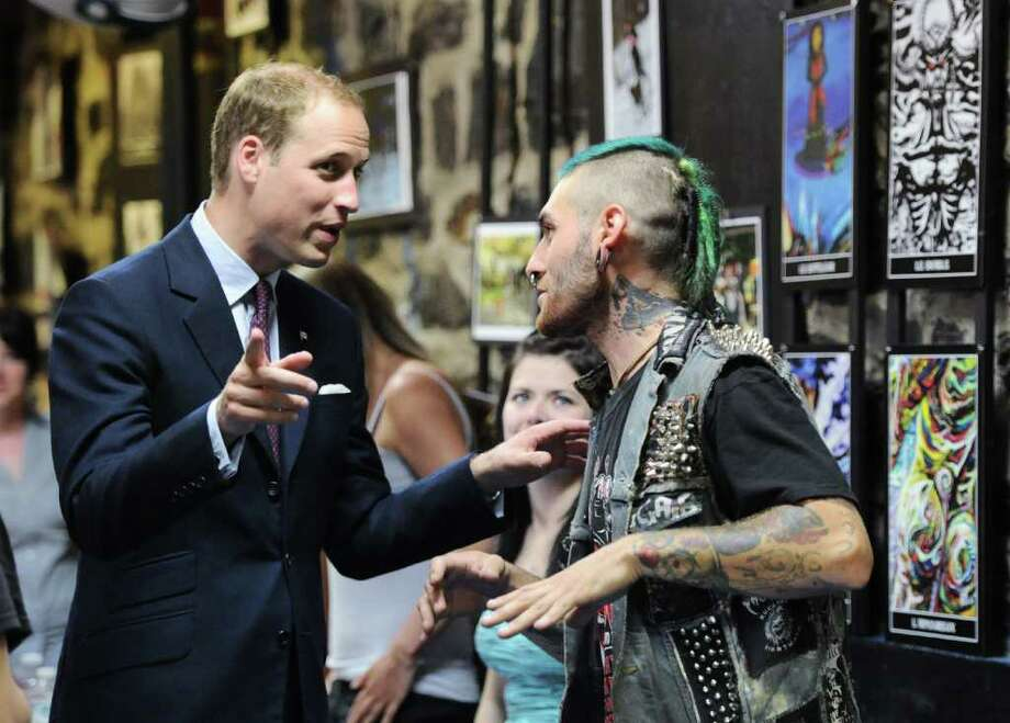 The Duke of Cambridge talks to young man after he performed a juggling act as he tours la Maison Dauphine, a youth shelter,  in Quebec City, Sunday, July 3, 2011. (AP Photo/The Canadian Press, Sean Kilpatrick) Photo: Sean Kilpatrick