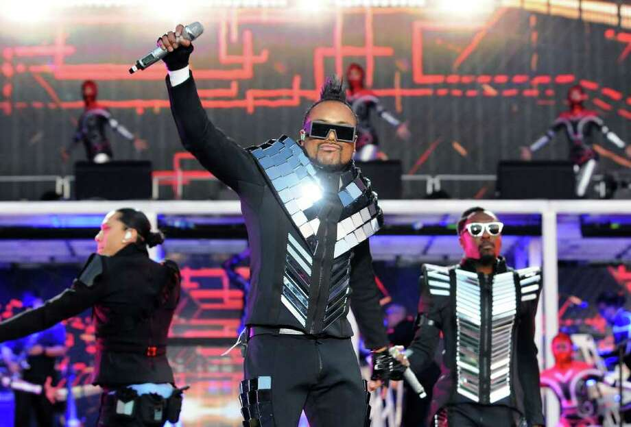 LONDON, ENGLAND - JULY 01:  (L-R) Taboo, apl.de.ap and will.i.am of The Black Eyed Peas perform live on stage during the first day of the Wireless Festival at Hyde Park on July 1, 2011 in London, England. Photo: Jim Dyson, Getty Images / 2011 Getty Images