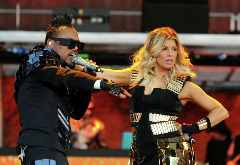 LONDON, ENGLAND - JULY 01:  Fergie and apl.de.ap of The Black Eyed Peas perform live on stage during the first day of the Wireless Festival at Hyde Park on July 1, 2011 in London, England. Photo: Jim Dyson, Getty Images / 2011 Getty Images