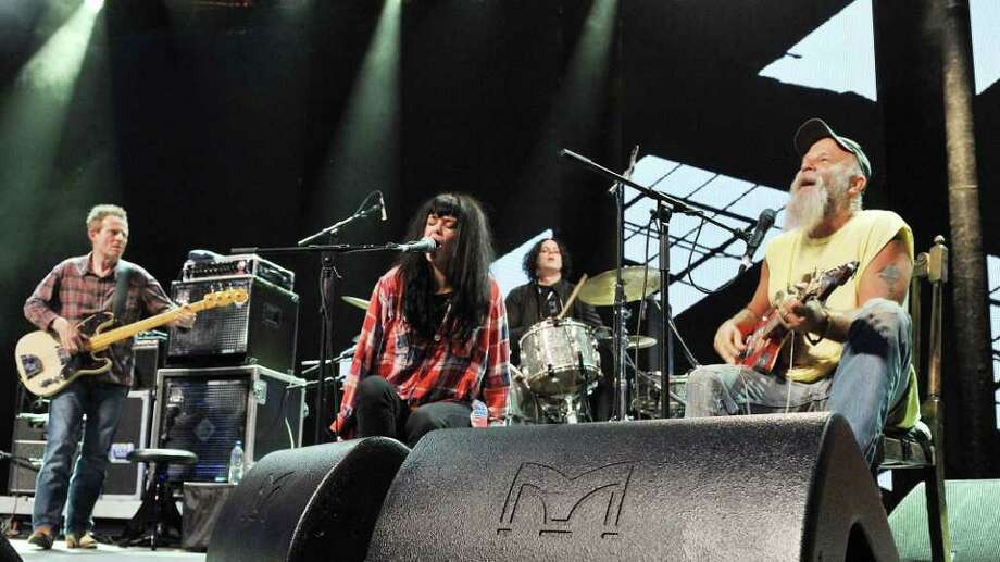Seasick Steve, right, with guests stars, left to right, John Paul Jones, bassist of Led Zeppelin, singer Alison Mosshart of The Kills and Jack White of White Stripes on drums, as they perform on stage at the Roundhouse in London, as part of the  iTunes Festival 2011, late Saturday July 2, 2011. (AP Photo / Nick Ansell, PA) UNITED KINGDOM OUT - NO SALES - NO ARCHIVE Photo: Nick Ansell, AP / PA