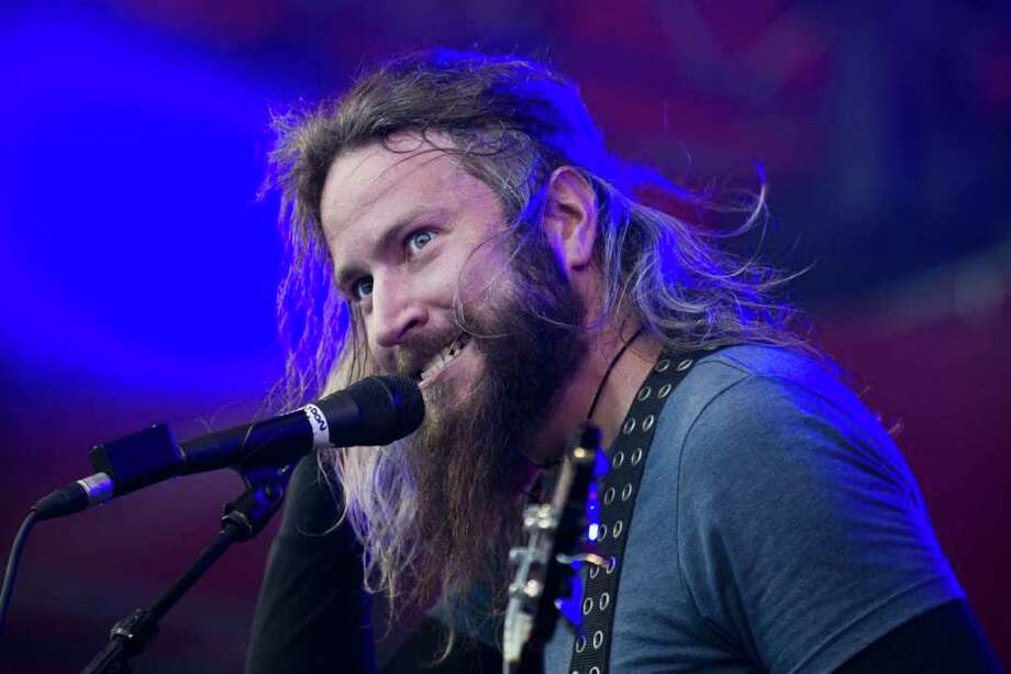 Troy Sanders, of US band Mastodon during a concert at the Roskilde Festival in Roskilde on Friday, July 1, 2011. Around 75.000 people attend the music festival, that ends Sunday. (AP Photo/Polfoto, Helle Arensbak)  DENMARK OUT Photo: ARENSBAK HELLE, AP / POLFOTO