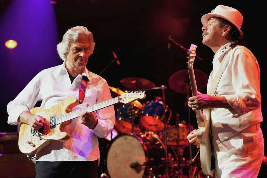 In this photo made available on Saturday, July 2, 2011, US guitarist Carlos Santana, right, and British guitarist John McLaughlin, left, perform on the Stravinski Hall stage during the 45th Montreux Jazz Festival, in Montreux, Switzerland, Friday, July 1, 2011. (AP Photo/Keystone, Laurent Gillieron) GERMANY OUT - AUSTRIA OUT Photo: Laurent Gillieron, AP / KEYSTONE