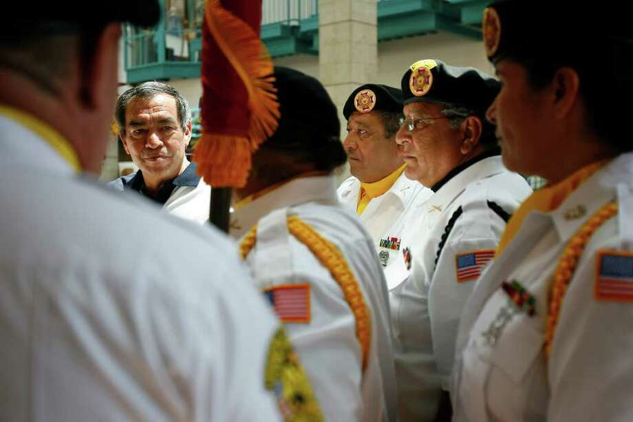 Retired Lt. Gen. Ricardo Sanchez talks with members of San Antonio's VFW Post 76 Honor Guard during the Salute to America music celebration at Wonderland of the Americas mall on Sunday, July 3, 2011. Photo: Sally Finneran/sfinneran@express-news.net / sfinneran@express-news.net