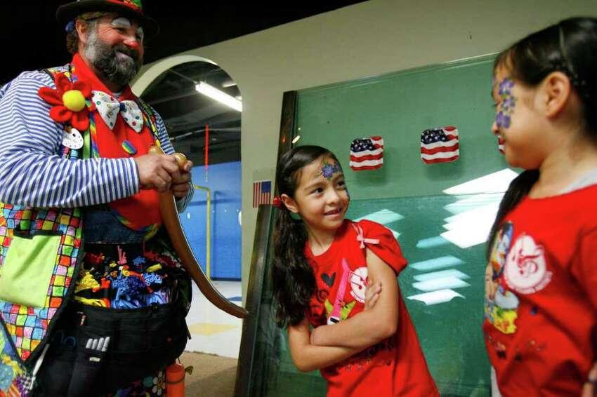 Samira Suarez, 8, (middle) looks at her sister Julissa Suarez, 9, while