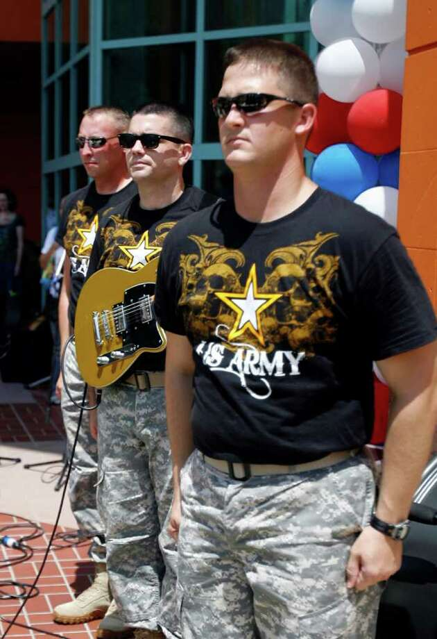 Members of The U.S. Army Medcom Band stand as the Pledge of Allegiance is recited at the Salute to America concert celebrating 4th of July. The free concert took place at Wonderland of the Americas mall on Sunday, July 3, 2011. Photo: Omar Perez/operez@express-news.net / SAN ANTONIO EXPRESS-NEWS