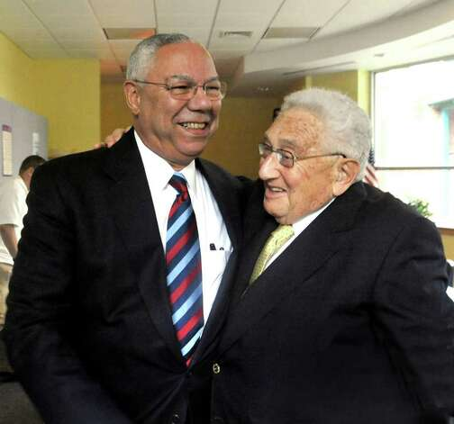 General Colin Powell, left, greets Henry Kissinger upon Powells arrival at the Kent Center School to speak at the Kent Lecture Series at the Library, Sunday, July 3, 2011. Photo: Michael Duffy