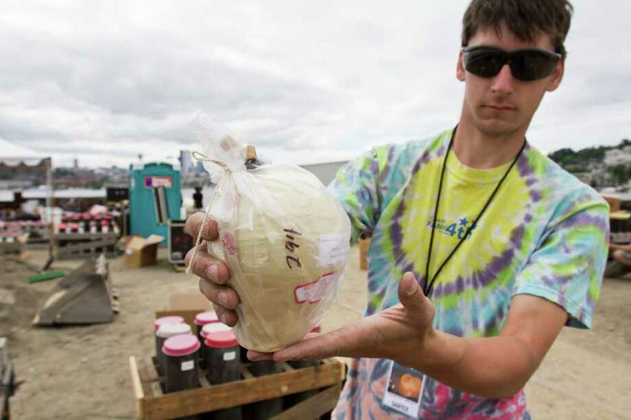 Sawyer Moe displaying a mortar to be used in the One Reel Family Fourth at Lake Union fireworks show, Seattle,  July 3, 2011 Photo: JOE DYER / SEATTLEPI.COM