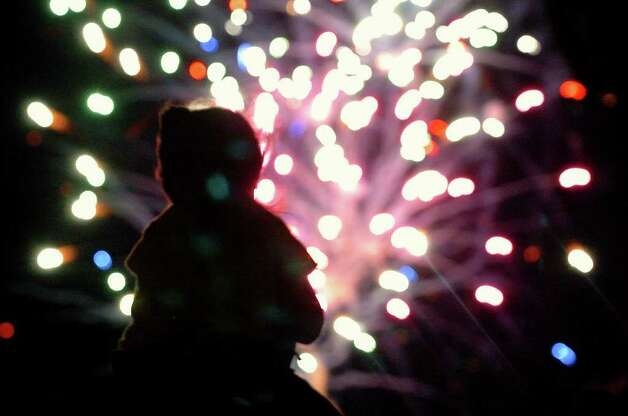 A little girl on her dad's shoulders to watch the Independence Day fireworks display after a Missions game at Wolff Stadium on Monday, July 4, 2005. Photo: Tom Reel/treel@express-news.net / SAN ANTONIO EXPRESS-NEWS