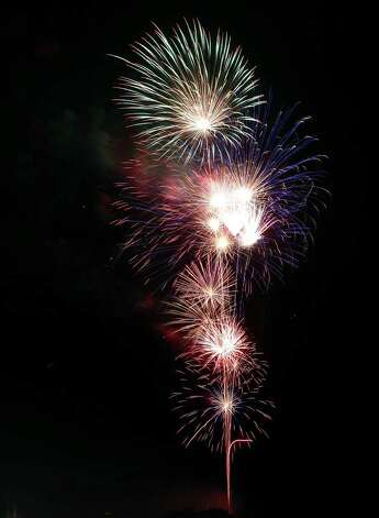 Fireworks explode on Sunday, July 4, during the 2010 Randolph AFB Independence Day fireworks show. Photo: Edward A. Ornelas/eaornelas@express-news.net / eaornelas@express-news.net