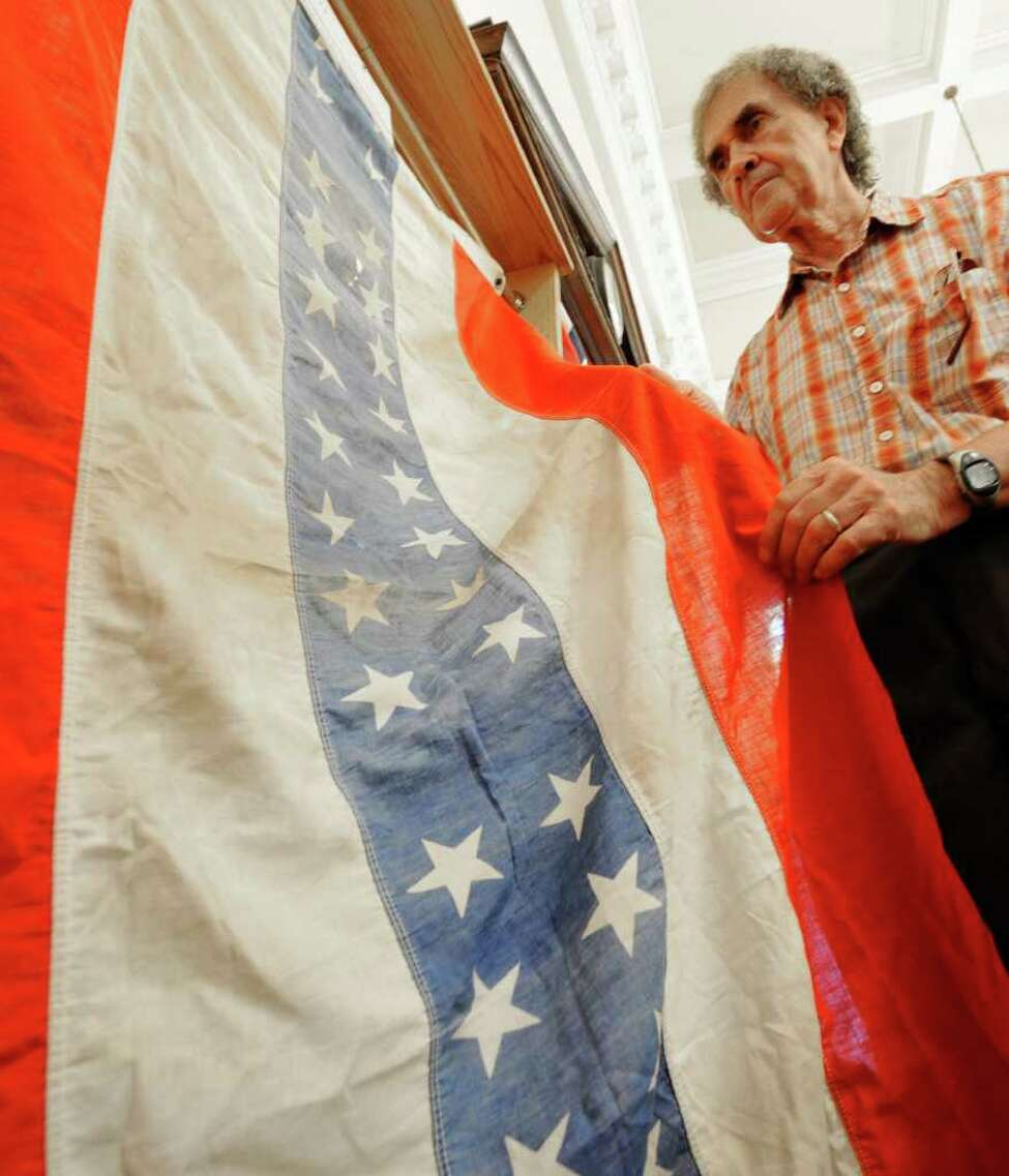 Flag collector Ron Soucy holds a 34 star banner at the Watervliet Historical Society building in Watervliet, N.Y. June 30, 2011. (Skip Dickstein / Times Union)