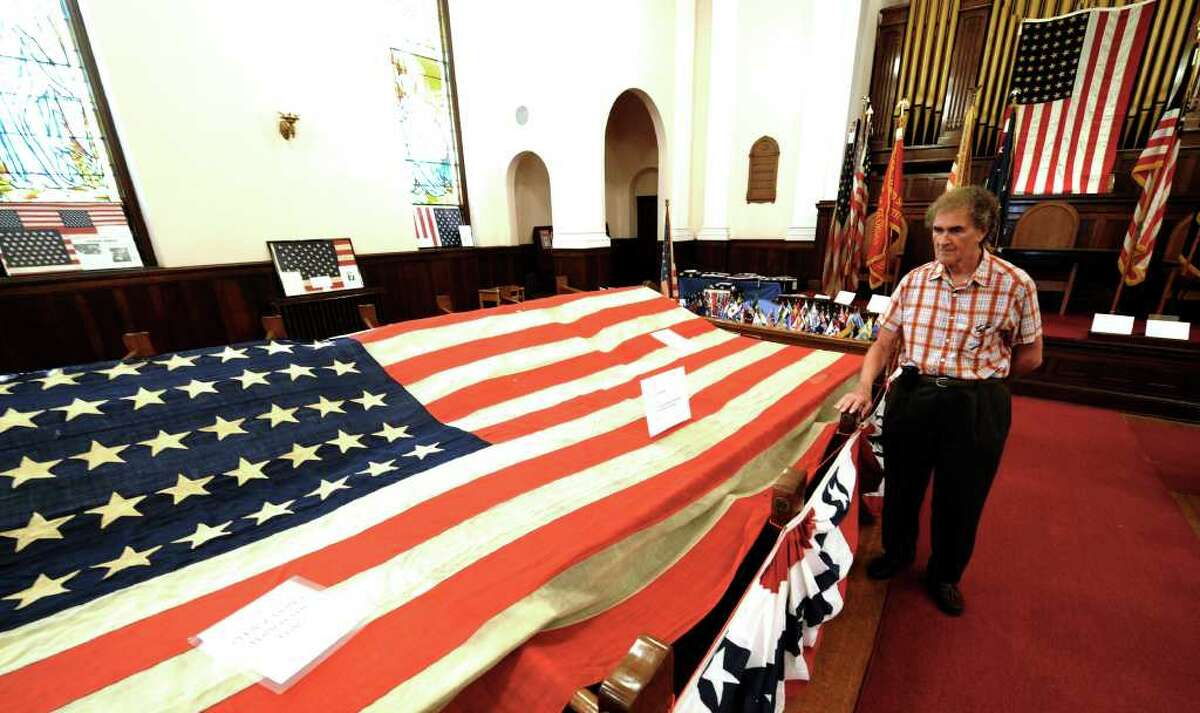 Flag collector Ron Soucy stands near a prized acquisition, an original garrison flag at the Watervliet Historical Society building in Watervliet, N.Y. June 30, 2011. (Skip Dickstein / Times Union)