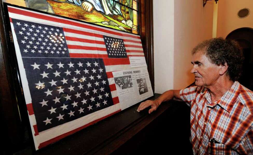 Flag collector Ron Soucy displays a 49 star flag at the Watervliet Historical Society building in Watervliet, N.Y. June 30, 2011. (Skip Dickstein / Times Union)