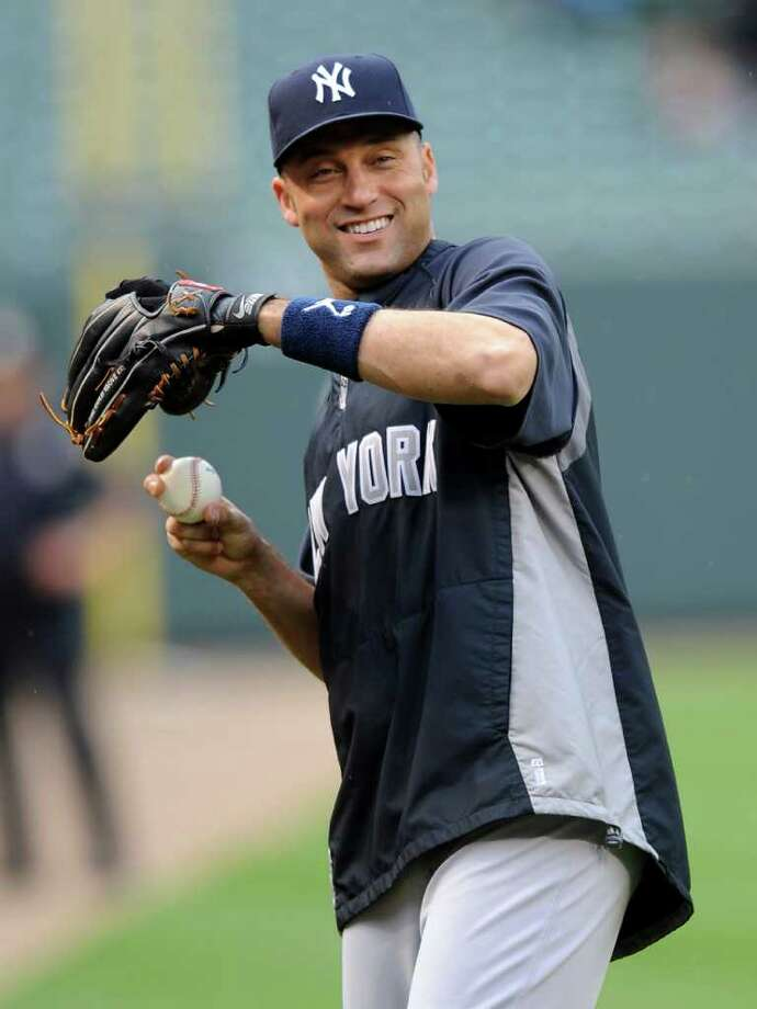 In this May 19, 2011, photo, New York Yankees shortstop Derek Jeter warms up for a baseball game against the Baltimore Orioles in Baltimore. Jeter is among four Yankees in the American League lineup for the July 12 All-Star game. (AP Photo/Nick Wass) Photo: Nick Wass