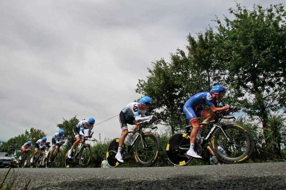 Team garmin cervelo strains during the second stage of the Tour de France cycling race, a team trial over 23 kilometers (14.3 miles) starting and finishing in Les Essarts, western France, Sunday July 3, 2011. (AP Photo/Christophe Ena) Photo: Christophe Ena